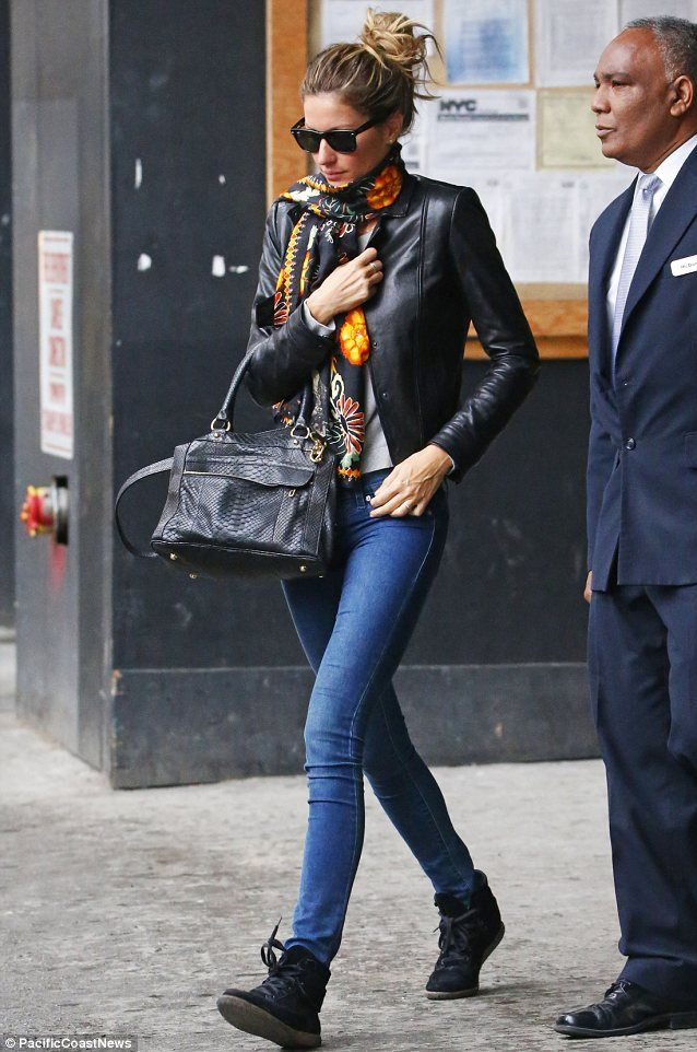 Stylish: Gisele Bundchen looked effortlessly elegant in skinny jeans and a leather jacket ...