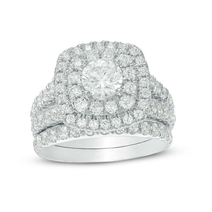 Proclaim your love with this exquisite certified Canadian diamond bridal set. Crafted in 14K white gold, the engagement ring features a sparkling 3/4 ct. certified Canadian diamond boasting a color rank of I and clarity of I2. Two cushion-shaped diamond-adorned borders surround the center stone, while two rows of diamonds line the split cathedral shank. On your wedding day, a coordinating diamond band completes the ensemble. Radiant with 2-1/2 cts. t.w. of diamonds, this comfort-fit...