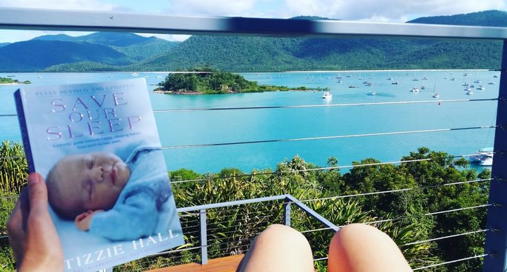 Relaxing in Airlie Beach with Tizzie Hall's book