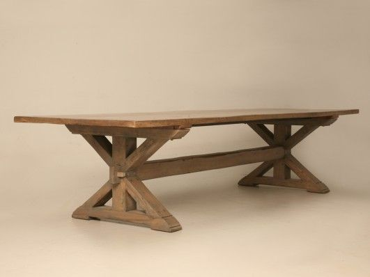 This table is an authentic copy of an 18th century French farm table and was made by the craftsmen here in our in-house workshop in Chicago. It was made from rift cut white oak boards with custom edging as specified by the client. The aged oak is kiln dried, planed and transformed into the highest quality furniture, all by hand in our on-site workshop.