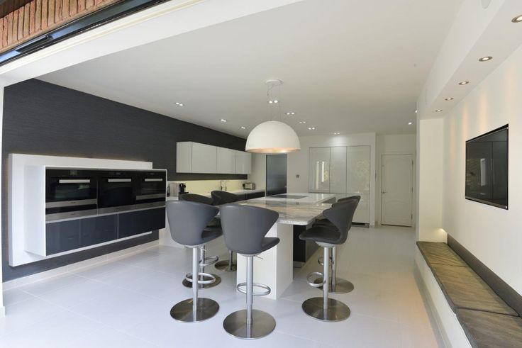 Spotlight task lighting and a statement pendant light are used in this sleek modern kitchen featuring Miele appliances designed by Diane Berry of Diane Berry Kitchens #kitcheninspiration