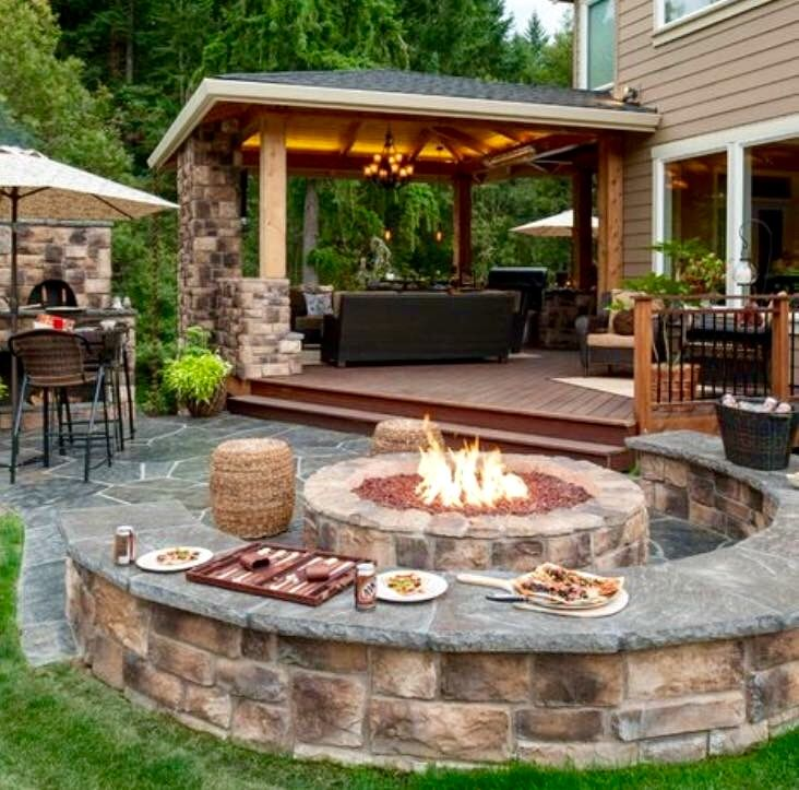 Stone outdoor living area and fire pit