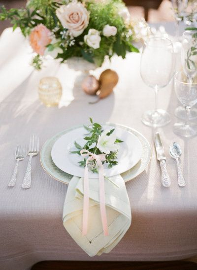 small floral bouquets wrapped in ribbon decorating plates