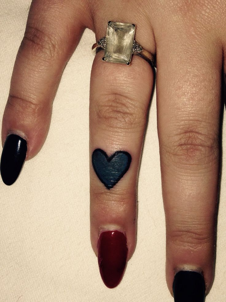 Cute little love heart, finger tattoo done by Bob at rude studio
