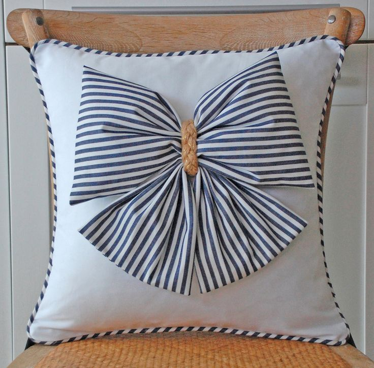 Puffy bow pillow cover. $35,00, via Etsy.