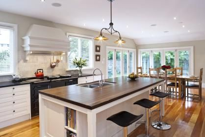 A Slice of England: The renovations done aimed to recreate the warmth of a European farmhouse kitchen. To ensure the space is functional and practical, the kitchen includes numerous drawers, shaped to suit their contents and including internal divisions and fittings, such as angled spice inserts, tray divisions and pull-out bins. Click the image for the full article.