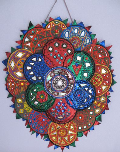 (keywords: craft, Indian-inspired, hanging CD, wall art, hand embroidery, recycled)