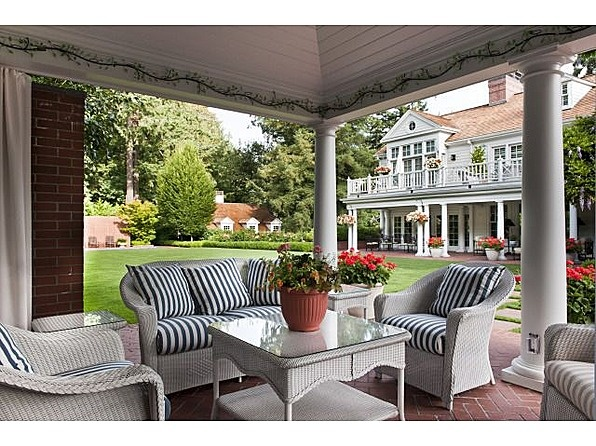 1.34 acre manicured grounds, gardens, pool, hot tub, terraces & guest house w/spacious office quarters.