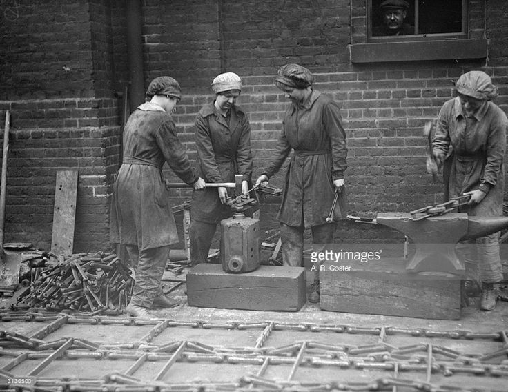 Women workers at the Gas Light and Coke Company at Bromley By Bow. Rivetting chains. June 11, 1918