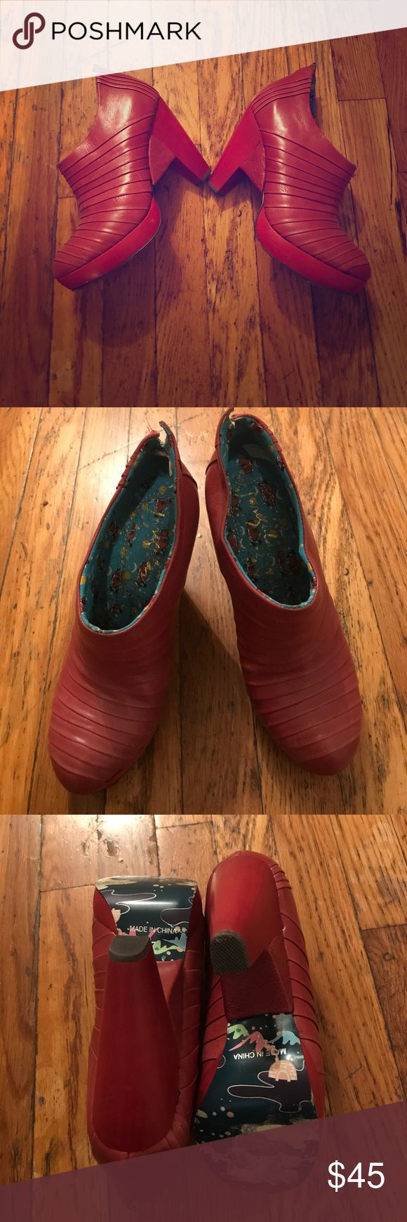 Irregular Choice Booties These red slip-on booties have all the funky details that are the Irregular Choice signature. Barely worn. Some scuffs/discolorations on the leather and the wood. Bottom sole on one still has some sticky residue/paper on it from where the sale sticker was. Very unique! They are slip-on. Make an offer! Irregular Choice Shoes Ankle Boots & Booties