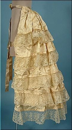 ivory silk lace trimmed lobster tail bustle, from 1894 wedding ensemble