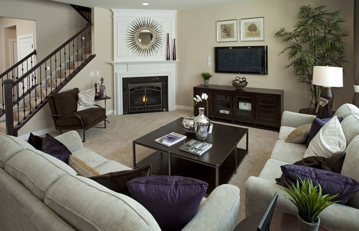 really like the staircase coming down into the living room with the fireplace in that corner...