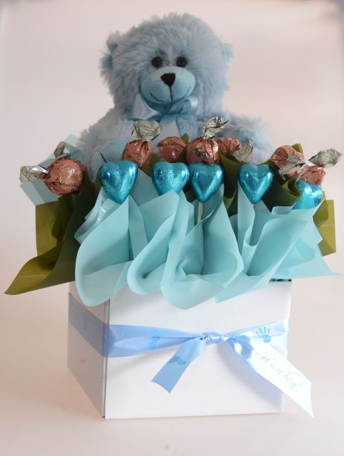 Cute and cuddly teddy with chocolate hearts and truffles