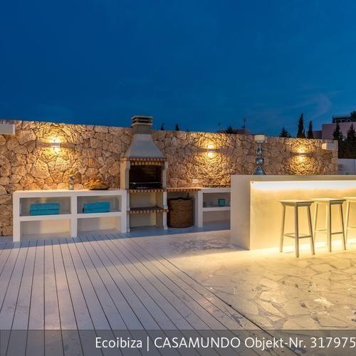 luxusvilla mit pool in spanien natursteinwand mit bar und grill