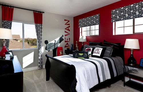 Kids bedroom in The Avonleigh with a fun karate theme and bright red accent wall! - Austin, TX
