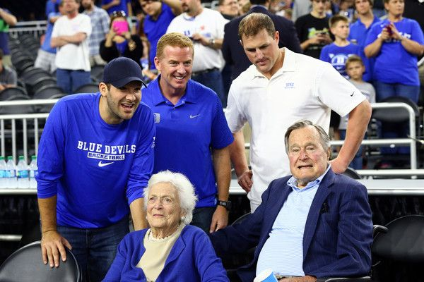 Tony Romo Photos Photos - (L-R) Tony Romo, Jason Garrett and Jason Witten of the Dallas Cowboys stand with former First Lady Barbara Bush and former President H.W. Bush prior to the South Regional Final of the 2015 NCAA Men's Basketball Tournament between the Duke Blue Devils and the Gonzaga Bulldogs at NRG Stadium on March 29, 2015 in Houston, Texas. - NCAA Basketball Tournament - South Regional - Houston