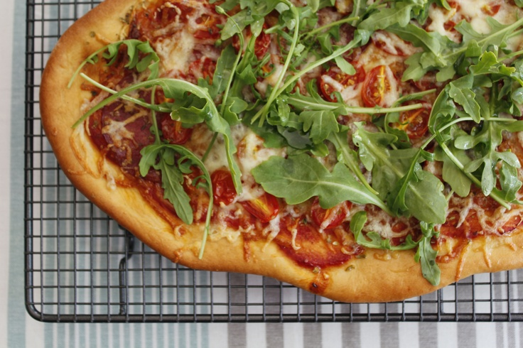 Pizza with cherry tomatoes,rocket and salami - http://hometalk.homechoice.co.za/content/pizza-cherry-tomatoes-rocket-and-salami