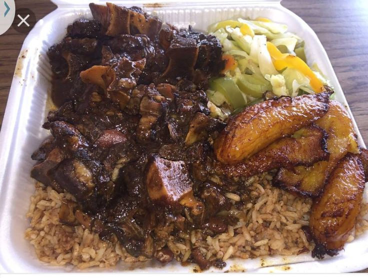 oxtail vegetables fried plantains  rice with peas