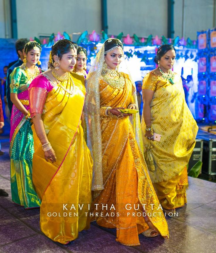 South Indian bride. Gold Indian bridal jewelry.Temple jewelry. Jhumkis.Yellow silk kanchipuram sari.Side fishtail Braid with fresh flowers. Tamil bride. Telugu bride. Kannada bride. Hindu bride. Malayalee bride.Kerala bride.South Indian wedding.