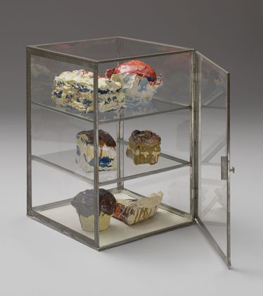 """Pastry Case  Claes Oldenburg (American, born Sweden 1929)    1961. Painted plaster sculptures in glass-and-metal case, 14 1/2 x 10 1/4 x 10 5/8"""" (37 x 26 x 26.9 cm)."""