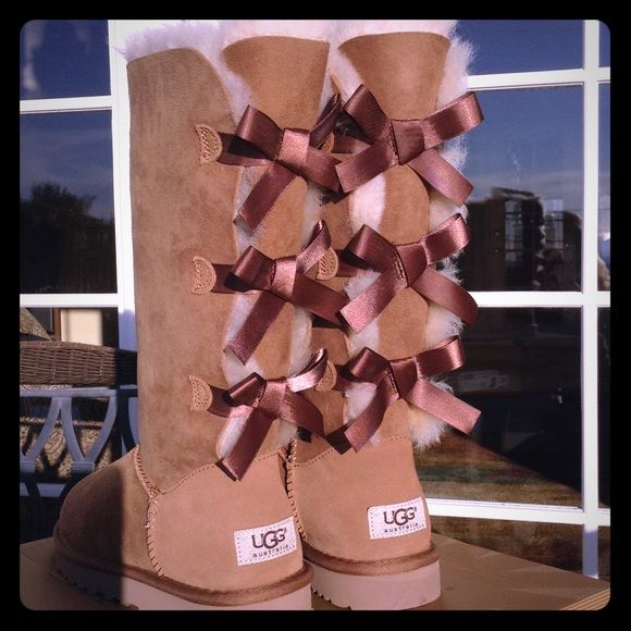UGGS Bailey Bow Tall Authentic Bailey Bow brown chestnut UGGS with three bows on back of boot. Size 7. Brand New, never worn, super CUTE!!! UGG Shoes Winter & Rain Boots