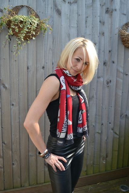 Red Moschino scarf, with leather trousers