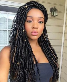 I love these goddess locs! (or faux locs) This could be my hairstyle for my wedding. :)