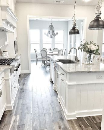 Kitchen opens to dining room but there's still separation between the spaces