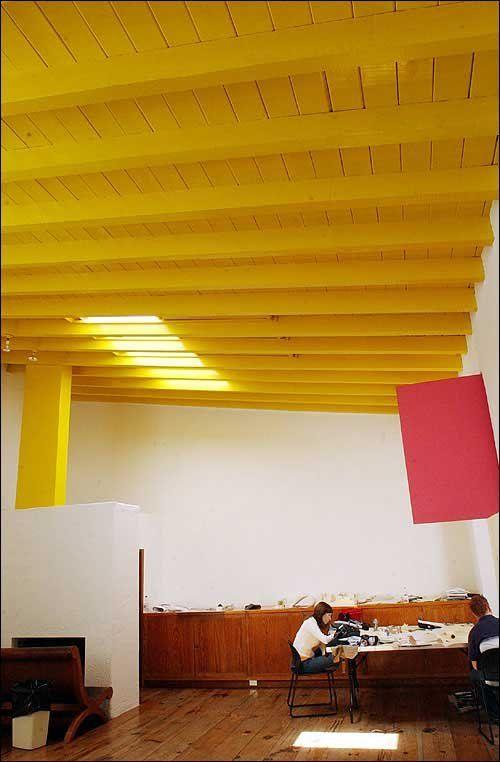 Luis Barragan's studio - yellow ceiling, messy studio. I love yellow ceilings