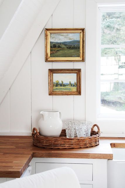 Love vintage paintings hung in the kitchen eclecticallyvintage.com