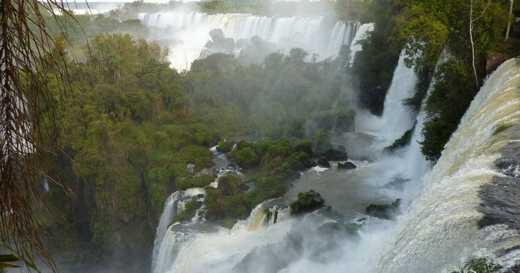 Iguazu Falls. The semicircular waterfall at the heart of this site is some 80 m high and 2,700 m in diameter and is situated on a basaltic line spanning the border between Argentina and Brazil. Made up of many cascades producing  ...