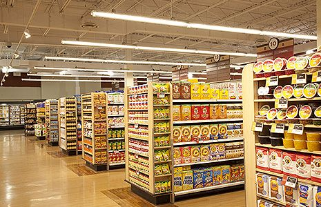 Heinen's Grocery Store aisle caps illuminated with GE Lumination LED lighting fixtures