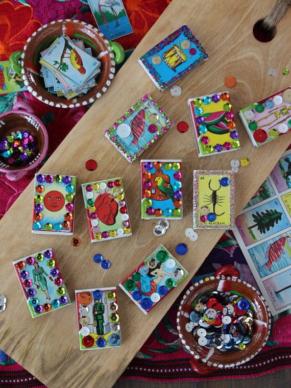 Handmade Loteria party favors are perfect for Mexican themed weddings and parties. Theyre sure to brighten up any fiesta. Handmade matchboxes are filled with wooden matches (matches can be replaced with colorful Mexican confetti at buyers request). Actual images may vary. Each matchbox is decorated with vibrant glitter and/or sequins. Price: $2 for one $18 per dozen Matchbox dimensions: approximately 2 x 1.5 x 0.5 Please message me for larger quantities. GIVING BACK: A portion of product…