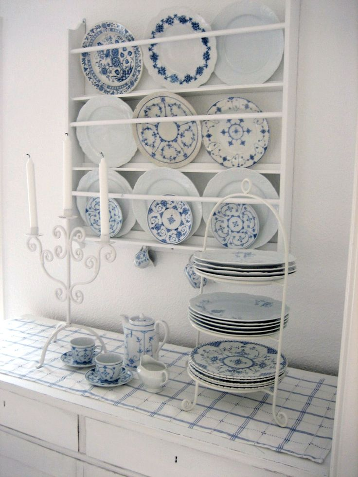 Scandinavian plate rack with assorted blue plates