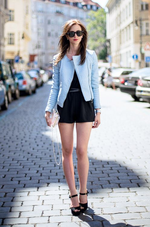 Shop this look for $146:  http://lookastic.com/women/looks/jacket-and-playsuit-and-belt-and-clutch-and-sandals-and-sunglasses-and-watch/2718  — Light Blue Leather Jacket  — Black Playsuit  — Black Leather Belt  — Transparent Clutch  — Black Suede Sandals  — Black Sunglasses  — Silver Watch