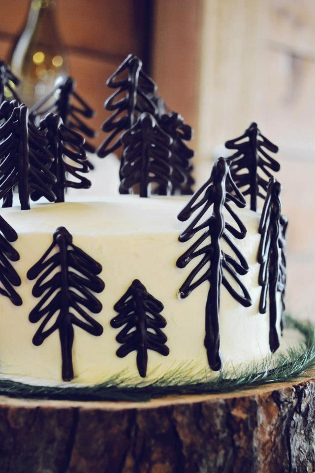 Rustic Woodland cake with what appears to be chocolate trees. YUM!