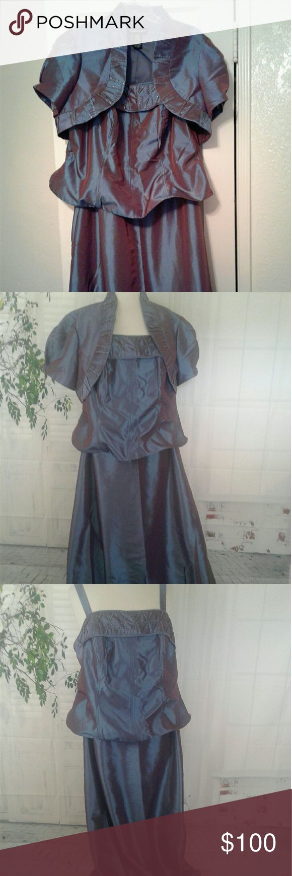 """Cachet Formal Dress Size 16W. Owner purchased new an wore once. Length approx 52"""" Gorgeous two piece formal dress. Sleeveless dress with a short jacket, short sleeves. Trim on jacket an neckline on dress have silver sequin accents. Top portion of dress is a pedalum  type. Zips up the back. Fabric has a halogen color effect. Questions, feel free to ask. Cachet Dresses Maxi"""