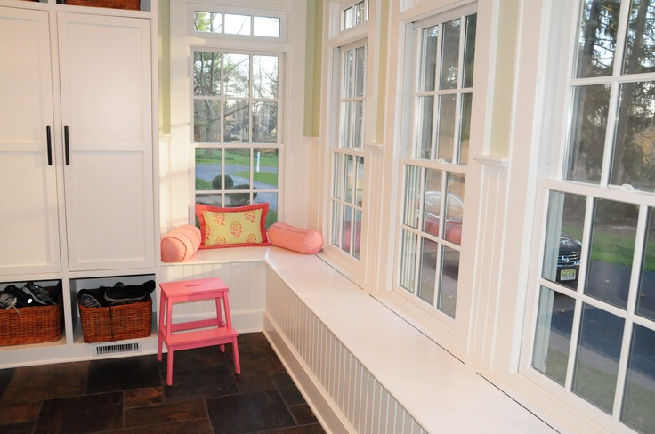 mudroom window benches have storage. Just lift the hinged seat.