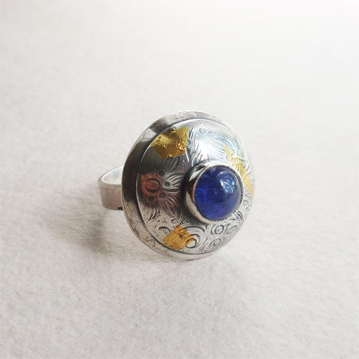 Sterling and fine silver ring with natural tanzanite and 24K gold accents. Handmade tanzanite ring