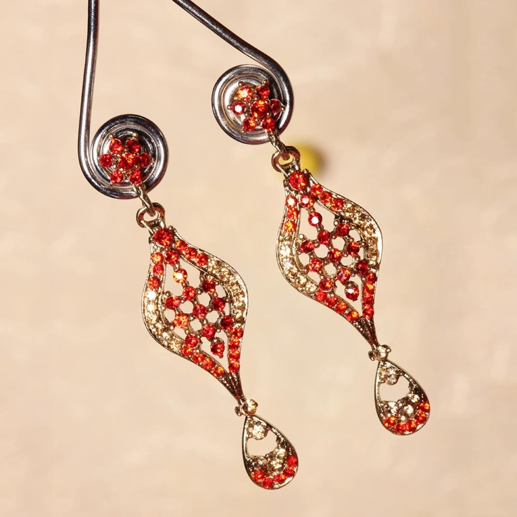 This earring looks very exceptional with that little flower at the top. Below hangs a nice meshed pattern with colored crystals on it.      Fashion Statement      You may try them with some of your traditional dresses.