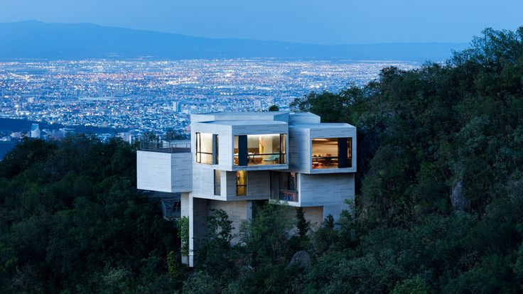 Tatiana Bilbao has completed a house comprised of pentagonal concrete blocks that emerge from a wooded slope to provide panoramic views towards Monterrey.