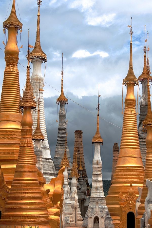 Myanmar - Pagodas. Facts about Myanmar:   Area: 676,577 sq km.  Basin and delta of the Irrawaddy River ringed by a horseshoe of high mountains that isolates the country from India, China and Thailand.  Population: 50,495,672. Capital:  Naypyidaw.  Official language: Burmese.  116 languages.