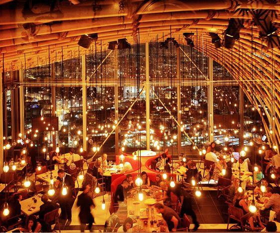 SUSHISAMBA, London. High ceilings, low-hanging lights.
