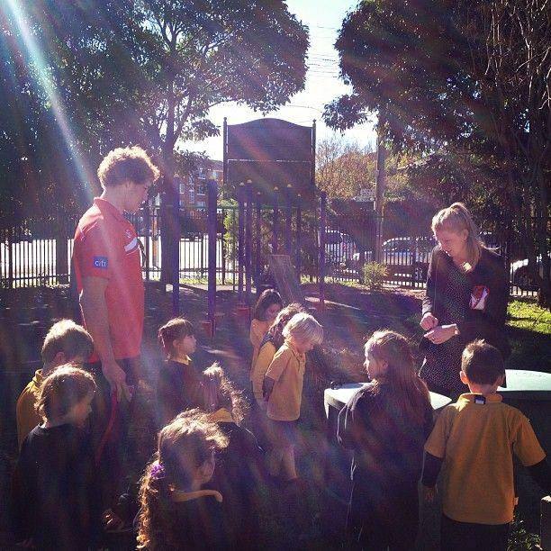 Shane Mumford learning about the Randwick Public School veggie patch