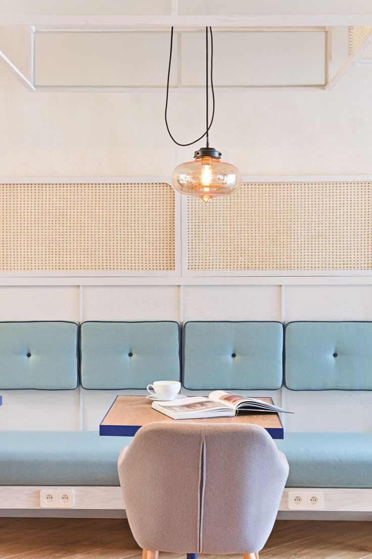 Cafe in Poland with turquoise booth seating and pastel chairs