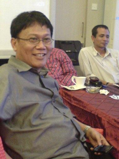 Erwin Moeslimin Singajuru, SH