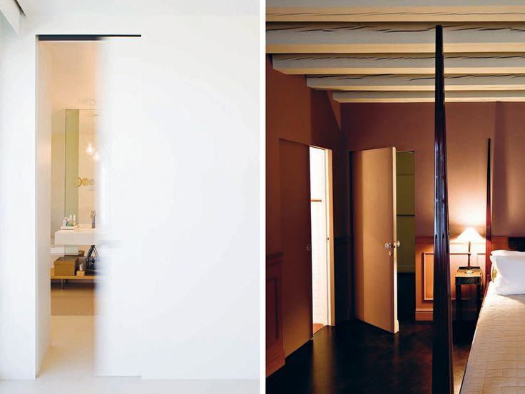 Linvisibile Motorized Concealed Sliding door, project by Profili Associati Architects in a private house. Detail of mouvement of a door finished as the wall.