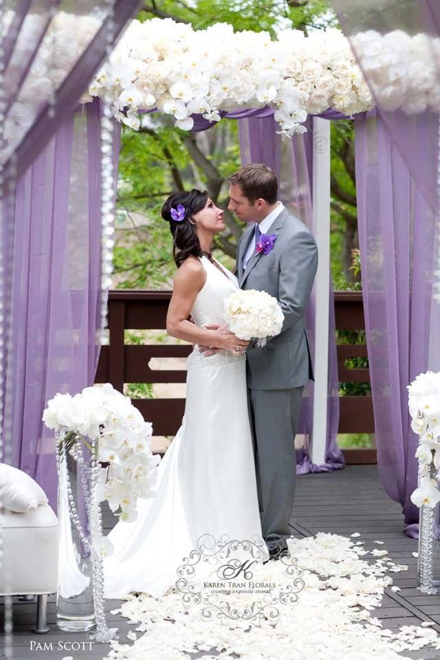 PURPLE!  I wouldn't use purple but i love the flowers.  just a simple white drape will do