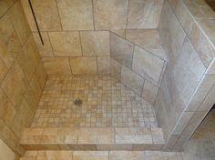 Tile Shower w/ built in corner seat & shelving in Littlerock, CA by Yelton's Flooring & Construction