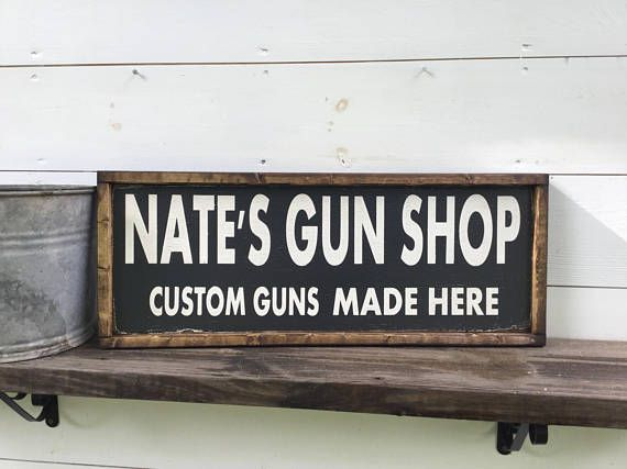 Personalized gun shop sign It is 10 x 26 with its frame which is ...